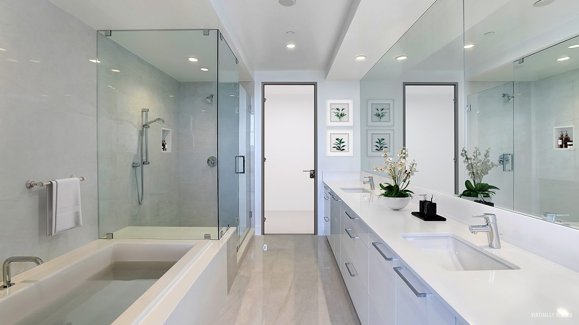 master bathroom with dual sinks and soaking tub and walkin shower